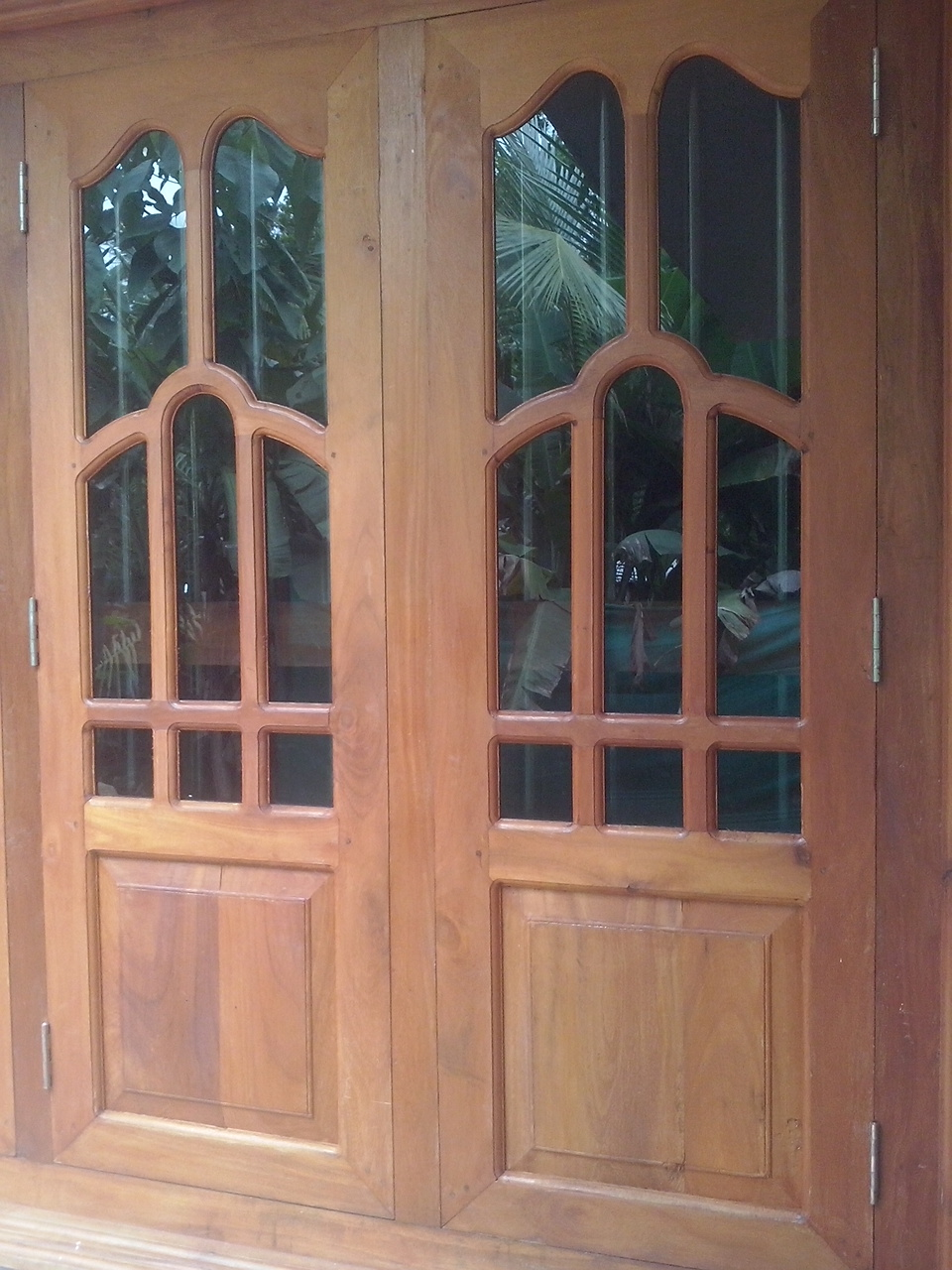 Bavas wood works kerala style wooden window door designs for Door and window design