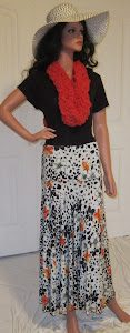 LDS Sister Missionary Maxi Jersey Knit with orange flowers and black paws on a white background.
