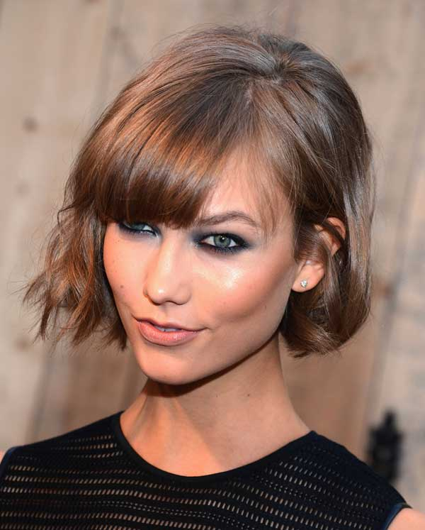 Karlie Kloss smile in latest Short Wavy Cut