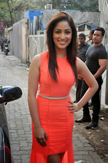 Yami Gautam Pictures in Orange Dress at Femina's Salon