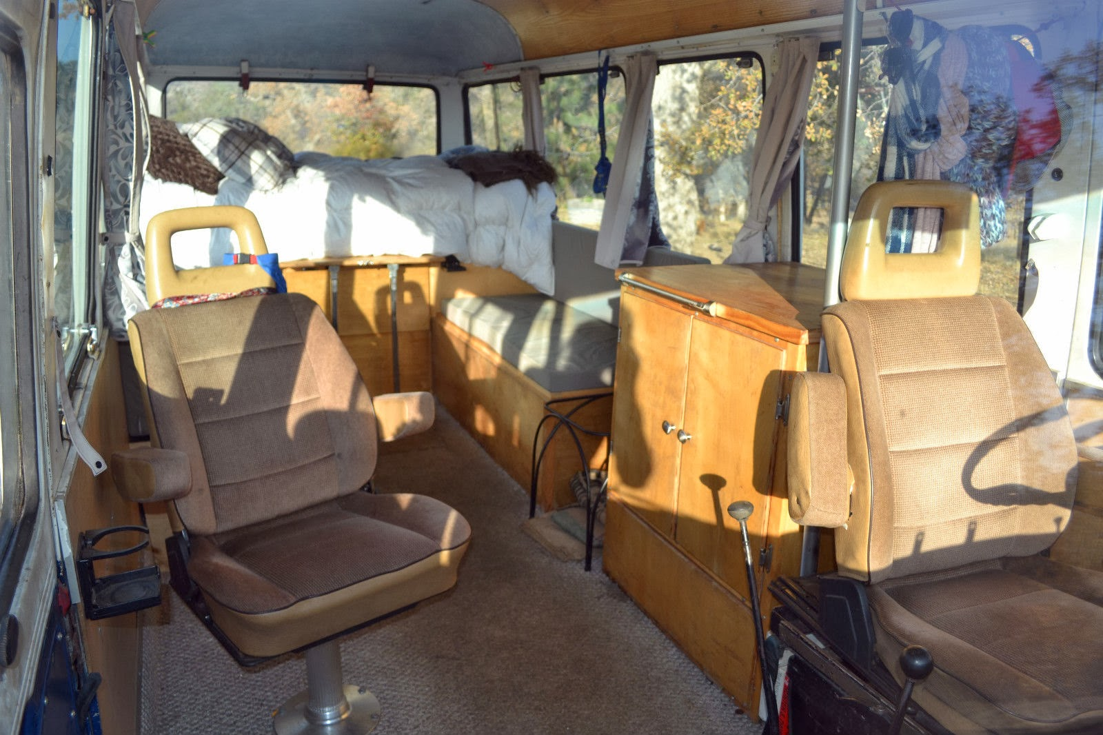 Inside There Are Two Captains Chairs Up Front And Padded Bench Seats . Full resolution‎  portrait, nominally Width 1600 Height 1066 pixels, portrait with #A57626.