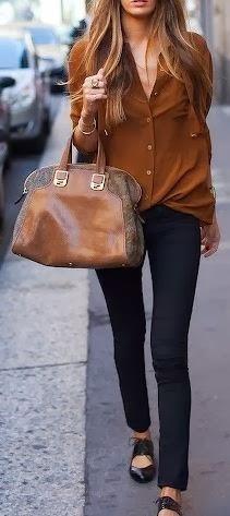 black pants khaki shirt with hand bag
