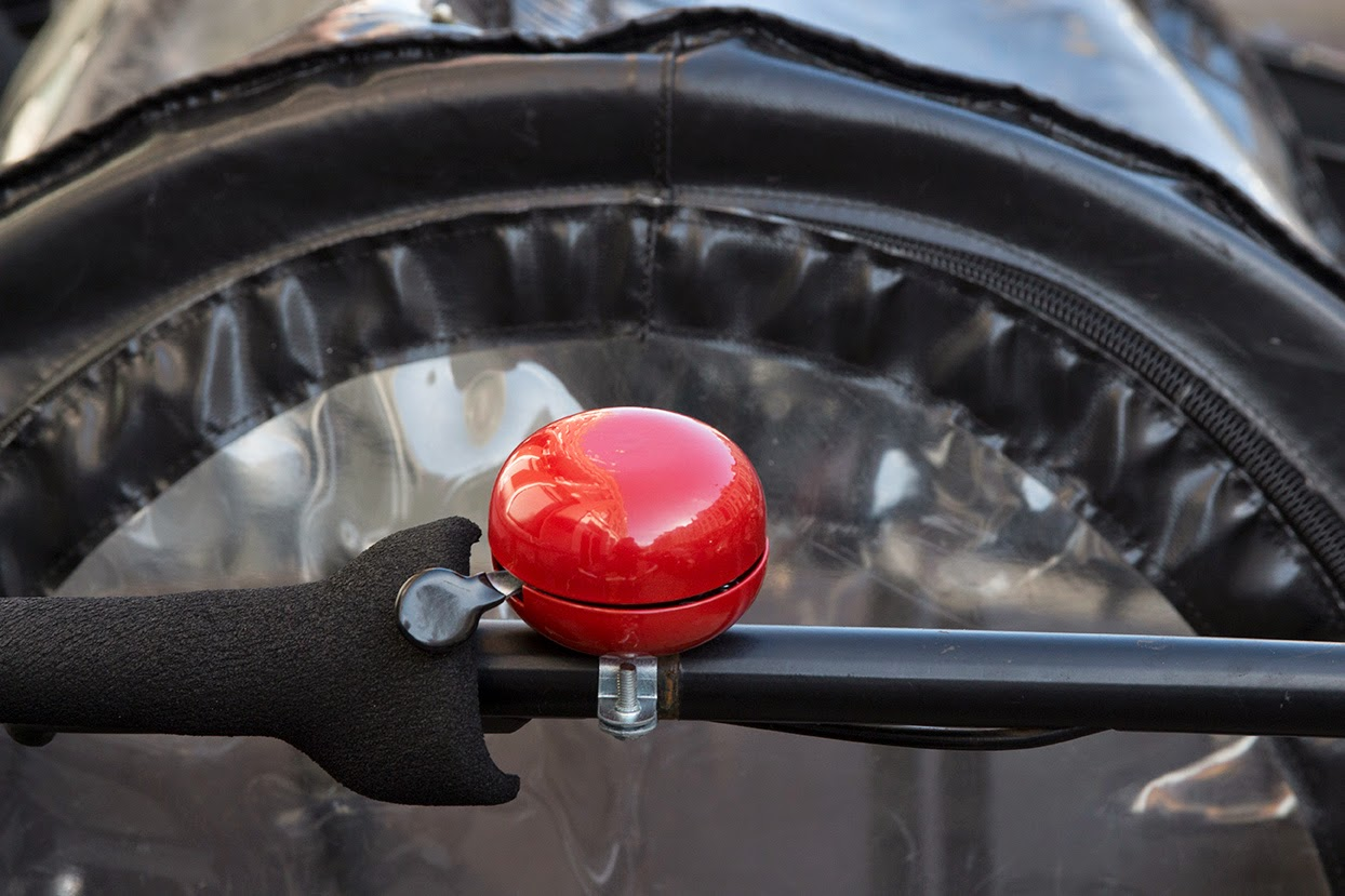 red bell on a black bicycle