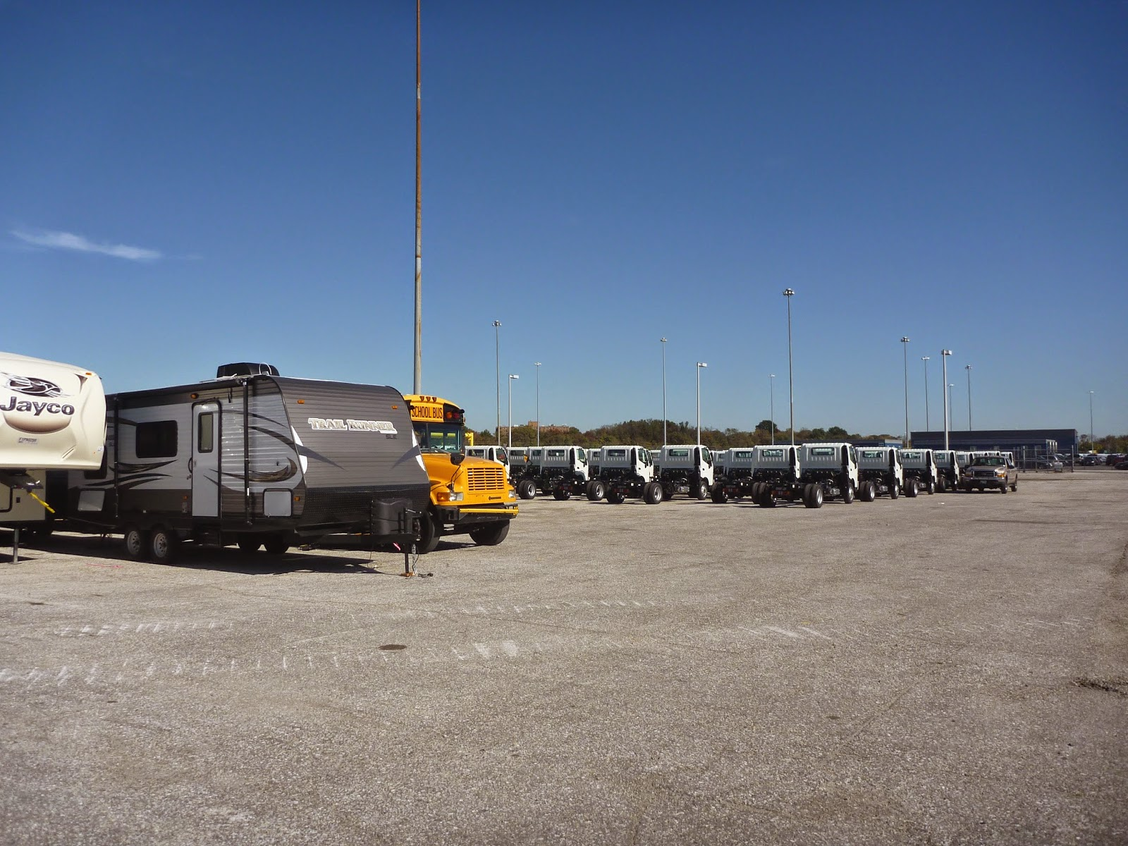 Mistubushi / Isuzu chassis cab trucks waiting to be loaded at Baltimore / Dundalk docks