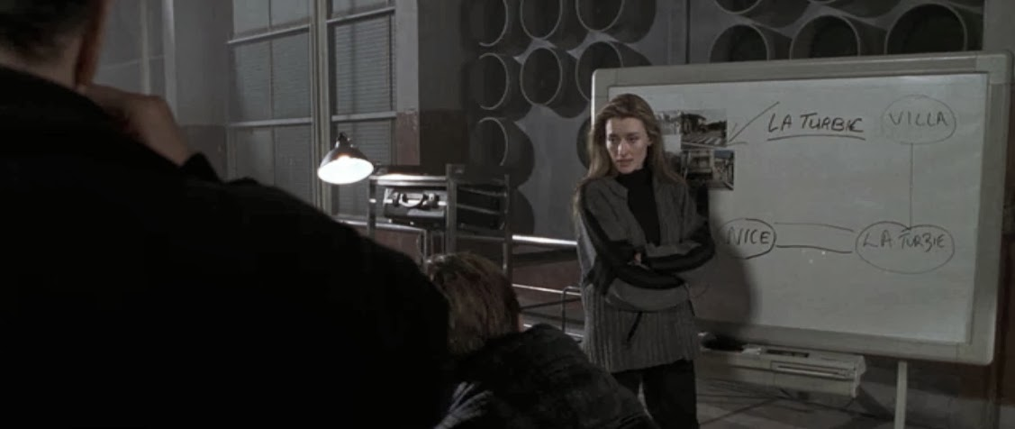 Natascha McElhone as the enigmatic and icy Irish lass Deirdre. Ronin, 1998. screenshot, striped sweater costume design - May Routh