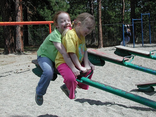 sisters on teeter totter