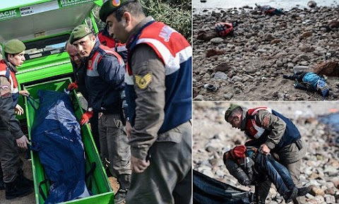 Children's bodies lie washed up on Turkish beach after more than THIRTY migrants die when their boat capsizes (Graphic Photos)