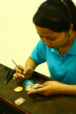 Assembling the earring at gold and silversmith workshop in Celuk Village