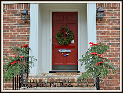 Front entry with garland - Dogs Don't Eat Pizza