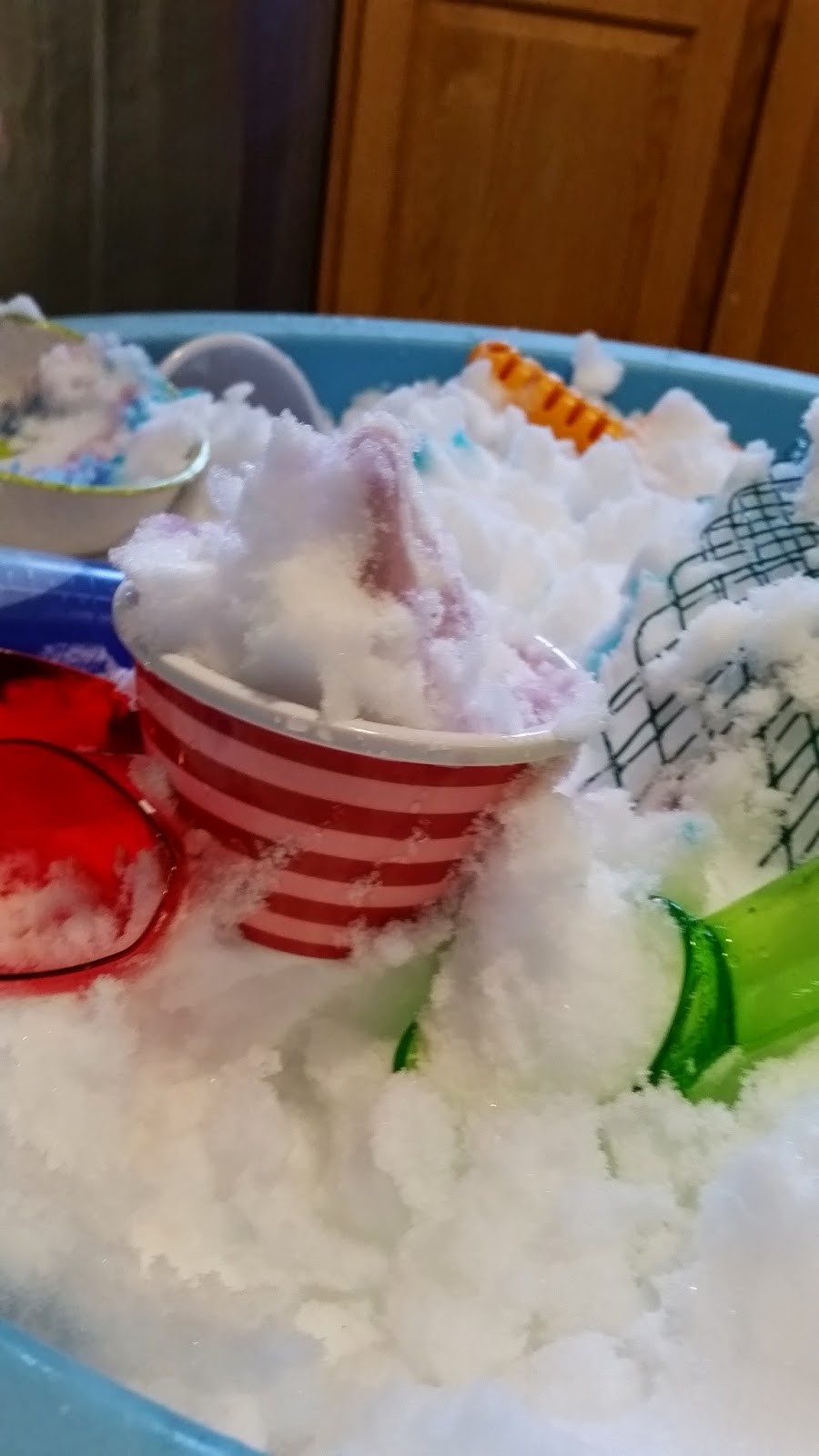 scoops, bowls and colored water for playing ice cream shop