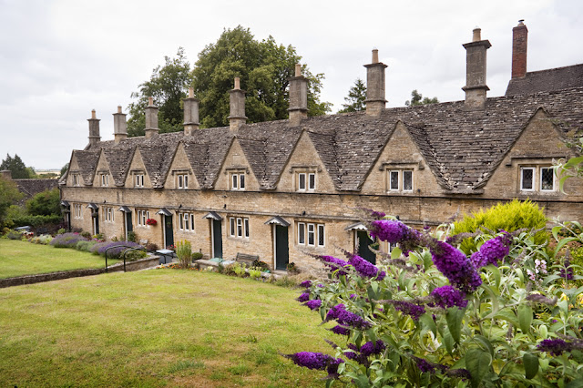 Almshouses at Chipping Norton with flowers in bloom by  Martyn Ferry Photography
