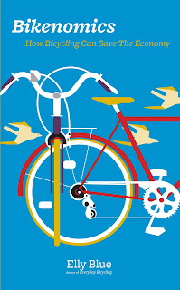 Book cover: Bikenomics by Elly Blue. Cover image depicts a bicycle  with birds flying past behind it. The entire image and title text is against a blue background.