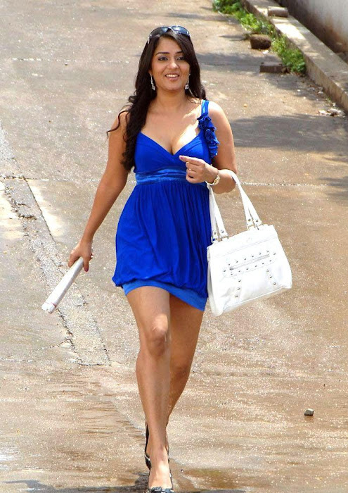 Nikitha in Blue Short Skirt Dress showing her thighs carrying a Handbag latest photos