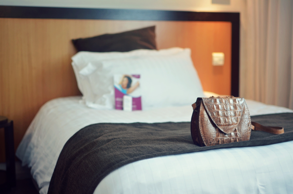 the bed in the crowne plaza bedroom in lille with the croco bag on it.