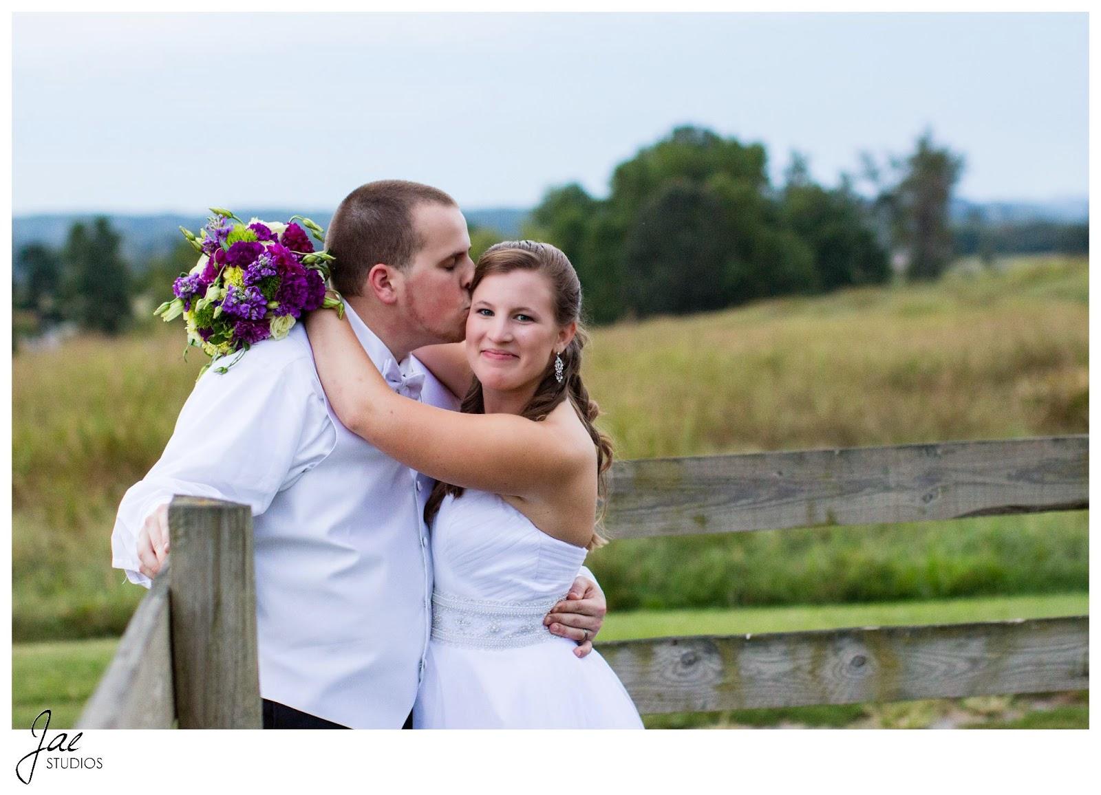 Jonathan and Julie, Bird cage, West Manor Estate, Wedding, Lynchburg, Virginia, Jae Studios, wooden fence, bouquet, flowers, purple, tuxedo, wedding dress, kissing, hugging