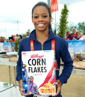 Gabby Douglas Holds Her Corn Flakes Box