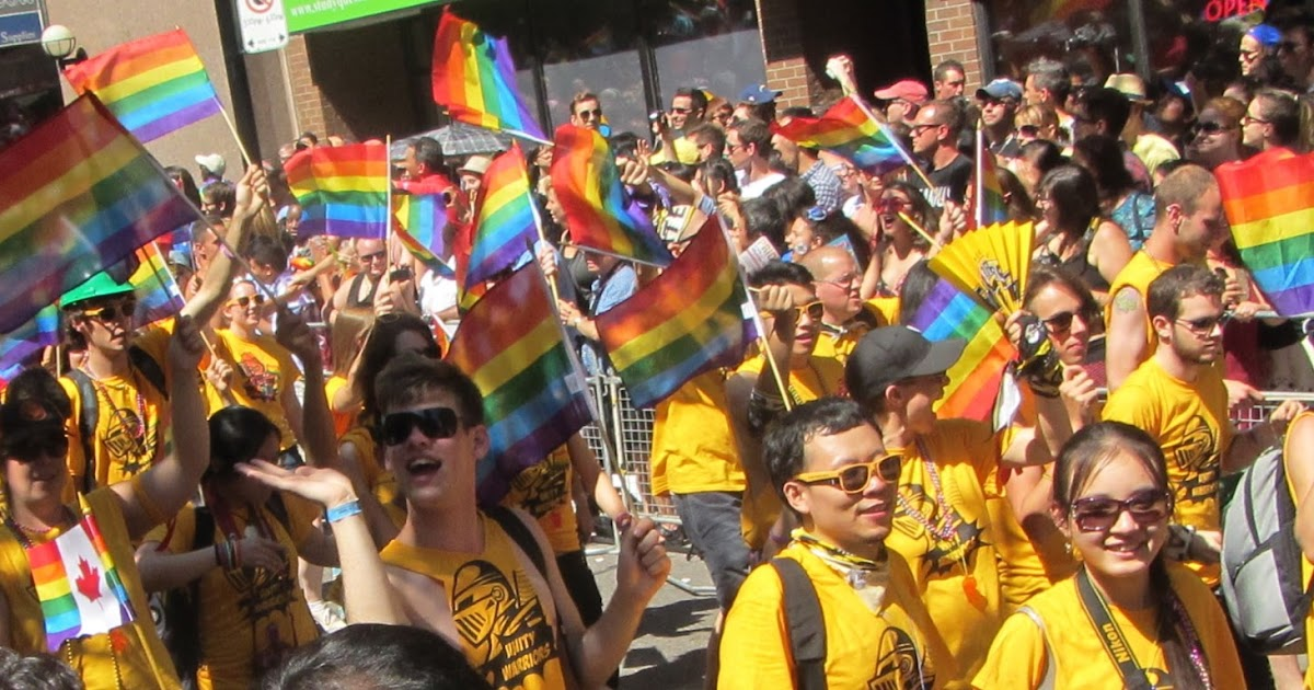 Gay pride parade revellers paint the city in rainbow