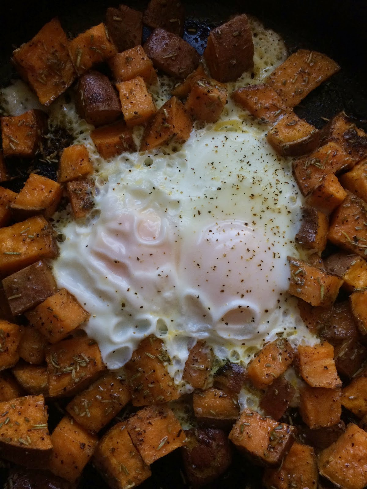 Two fried eggs nestled in a roasted rosemary sweet potato nest - so ...