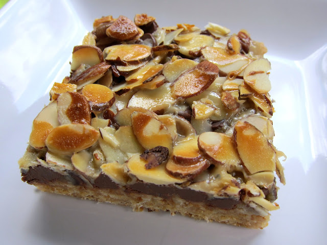 Almond Toffee Bars - graham cracker crust topped with almond bits, chocolate chips, sliced almonds and sweetened condensed milk - HIGHLY addictive. We could not stop eating these! Everyone always asks for the recipe when I bring them to parties.