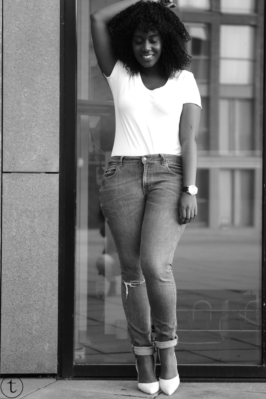 outfit post wearing basic items white tshirt and blue ripped jeans