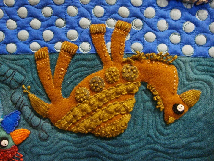 detail, camel, Travel Journal by Sue Spargo, wool applique wall quilt