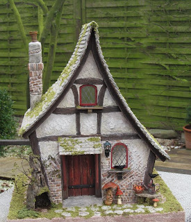 CDHM Artisan Karin Caspar of KC-Design creates 1:12 scale dollhouses using paperclay and spooky witch and wizard accessories in 1:12 scale