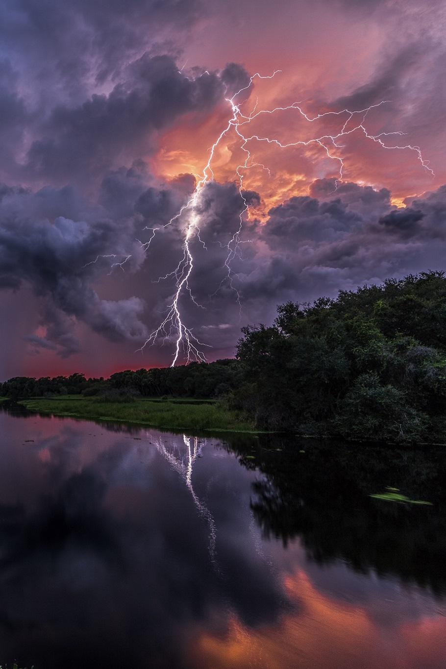 lightning and beautiful colors from the setting sun