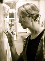 Artist Lisa Larrabee painting in her studio