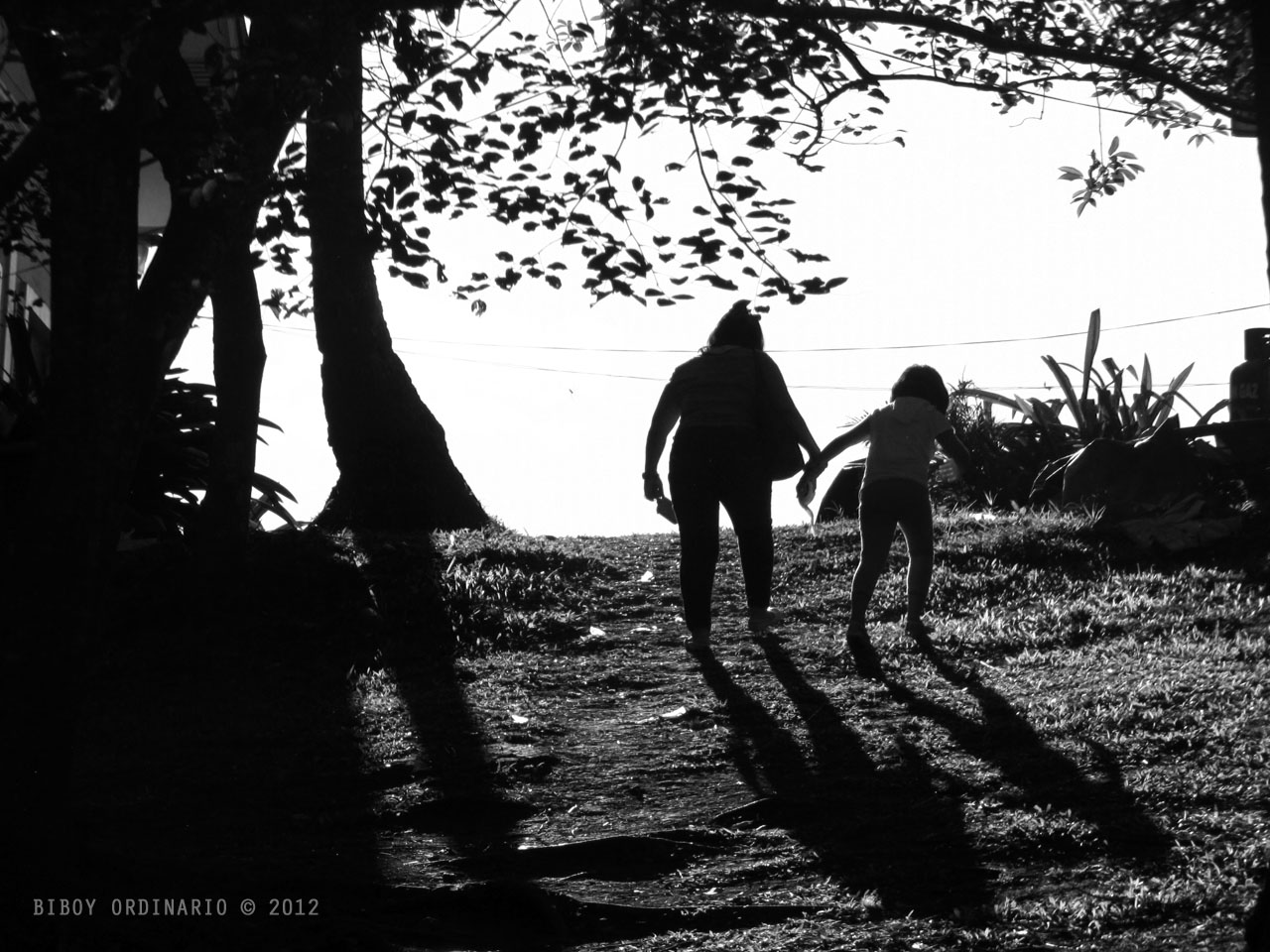 Silhouette of mother and toddler