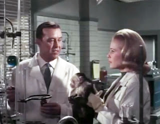 Ray Milland and Diana Van der Vlis in lab scene