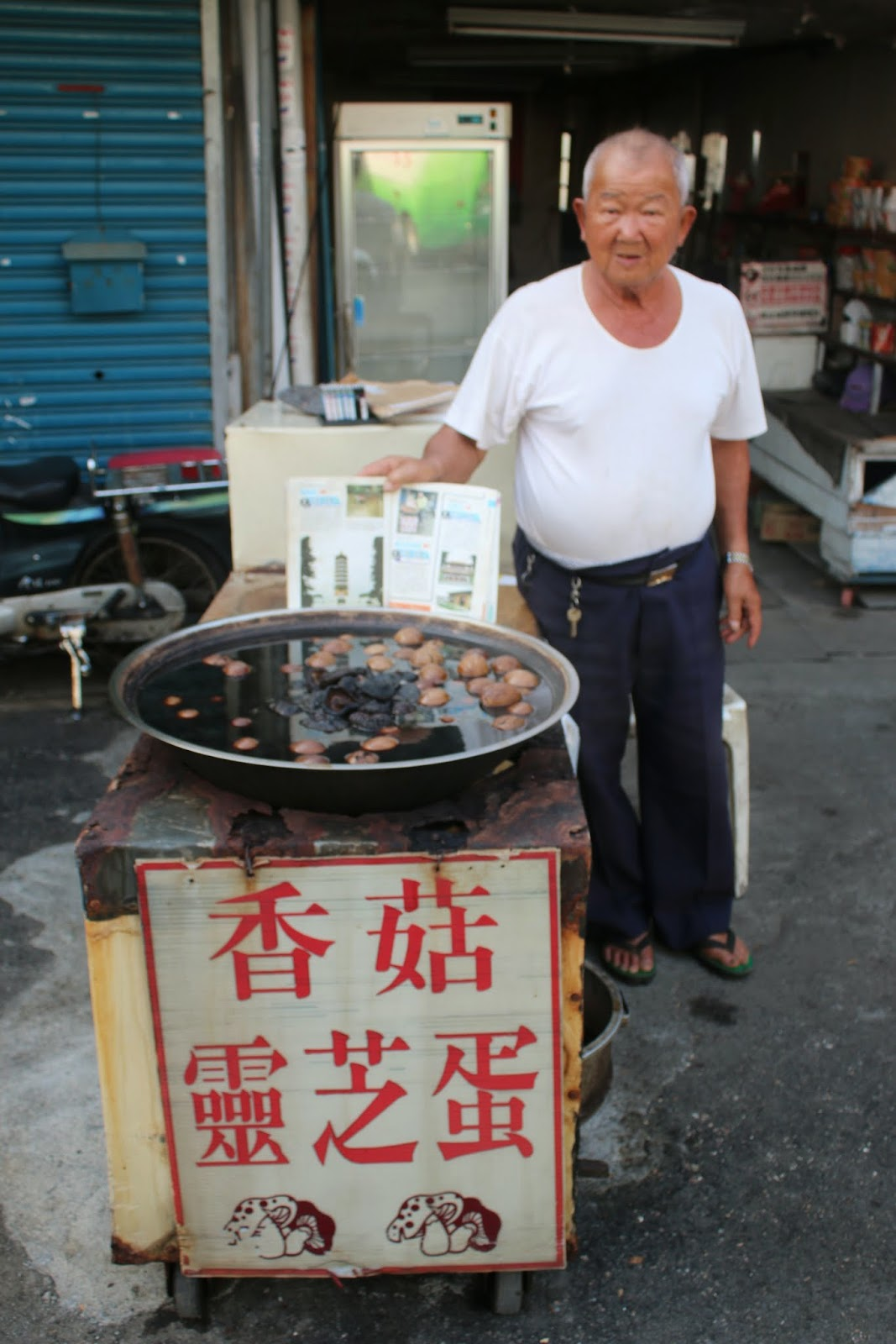 Cheap and famous Taiwanese Simmered Tea Egg sold by this old man opposite street of Xuanzang Temple in Nantou County of Taiwan