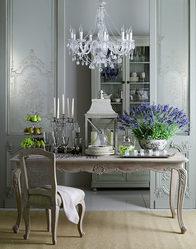An Ornate Crystal Chandelier Hangs Above Detailed Antique Furntiure To  Create A Space With Old World Charm. Part 94