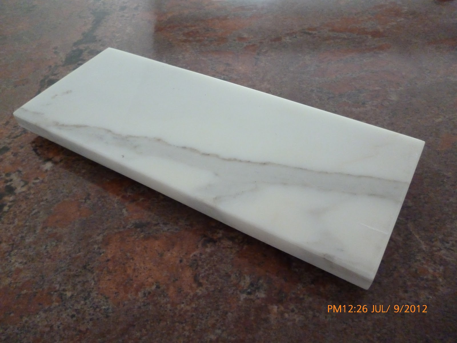 Piedra marmol granito y cuarzo mesas y tablas de picar for Piedra para granito