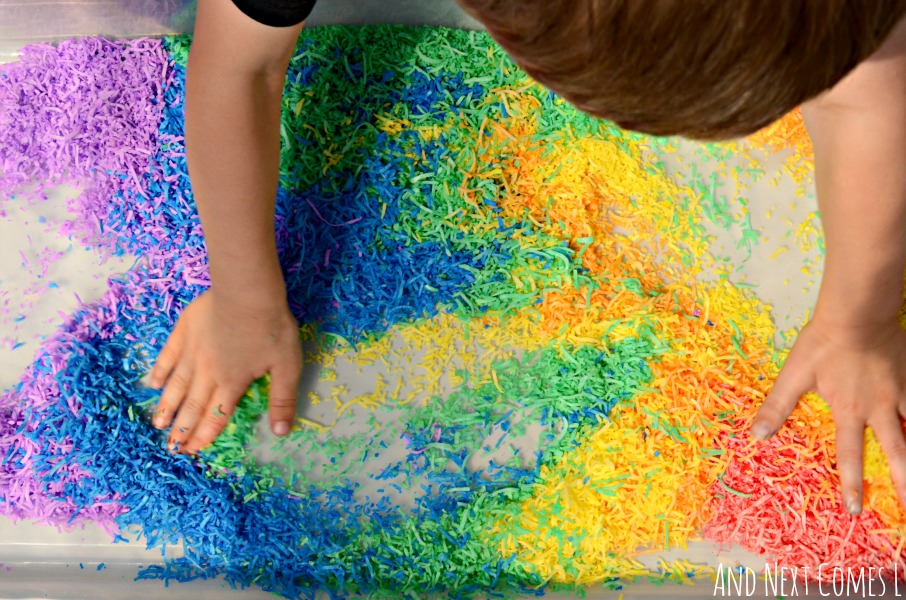 Rainbow dyed coconut sensory play from And Next Comes L