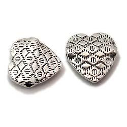 Heart shaped silver stamped flat beads