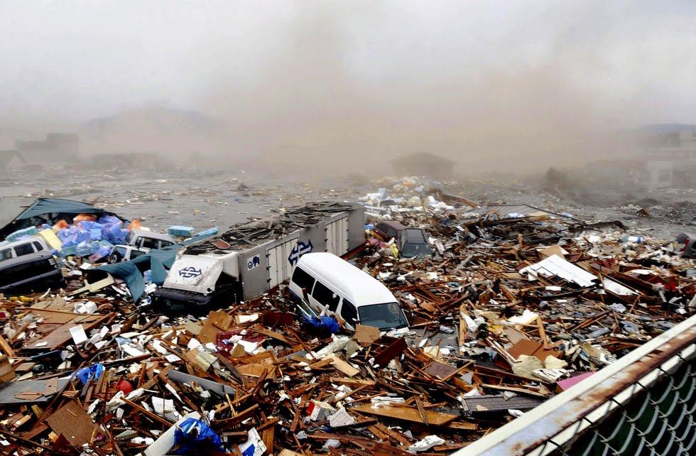 japan tsunami 2011 wave. A wave from the tsunami heads