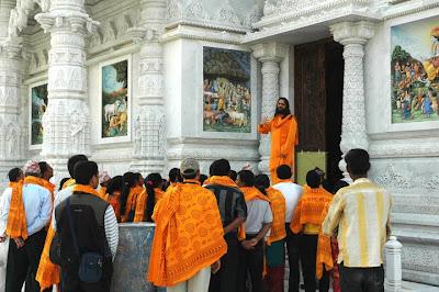 Devotees of Jagadguru Kripaluji Maharaj taking a tour of Prem Mandir