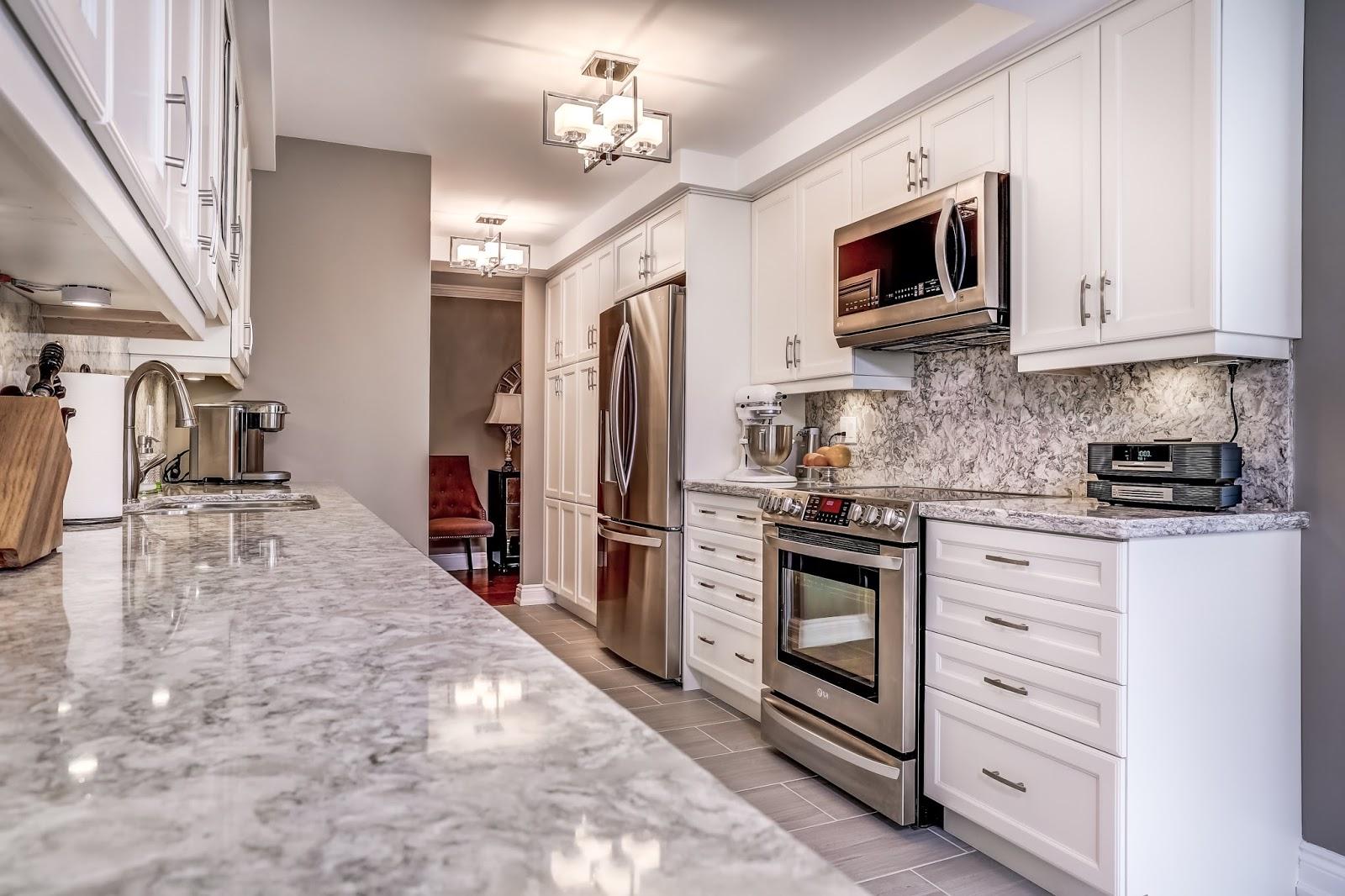 White Condo Kitchen Design By Monarch Kitchen U0026 Bath Centre. U201c