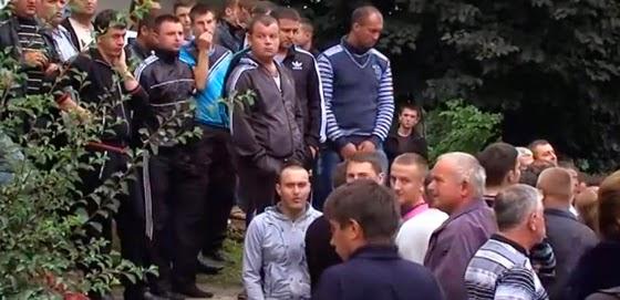Men line up for military draft in Ukraine.