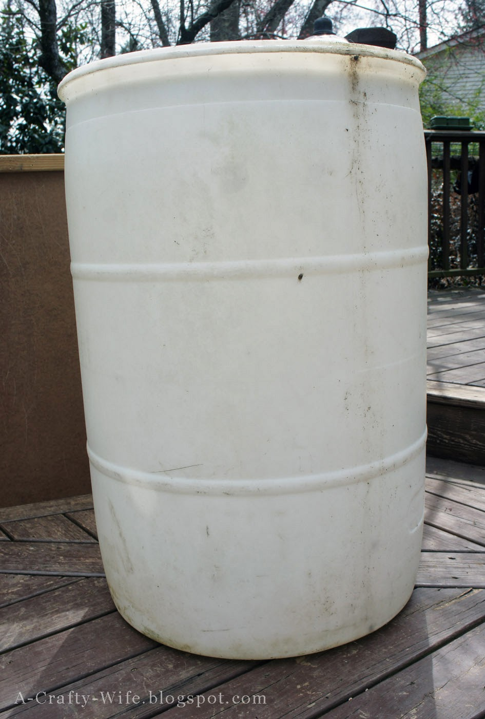 Use a 55 gallon drum for rain barrel | A Crafty Wife