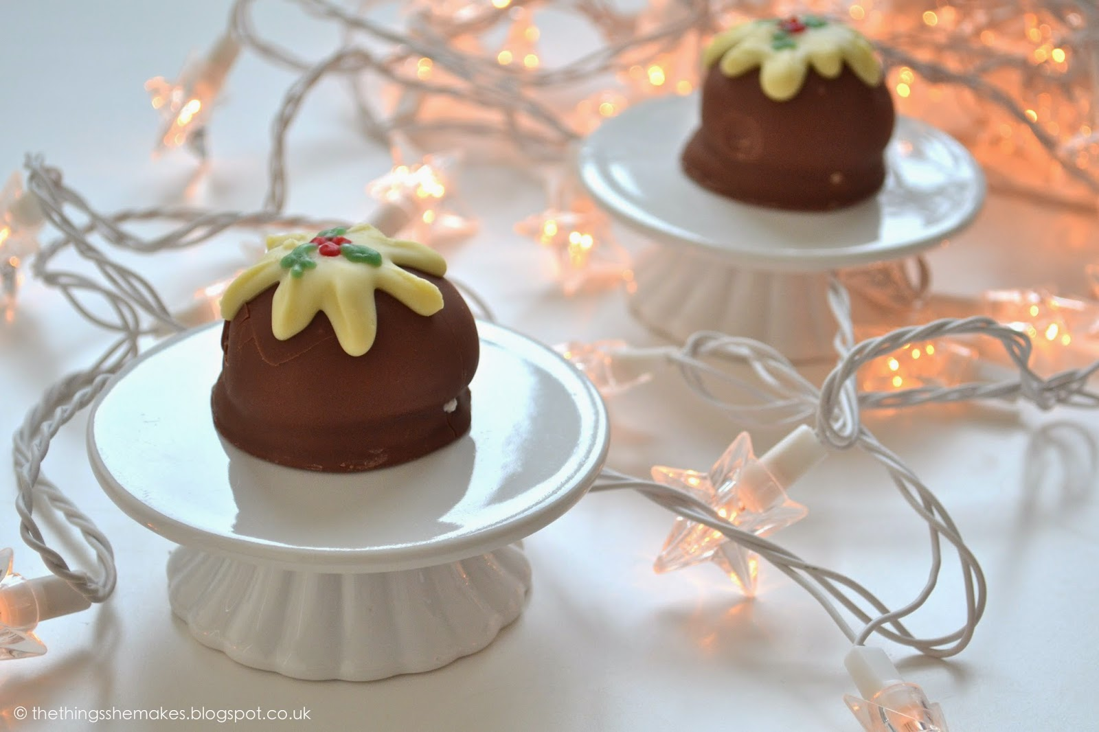 cannocks teacakes decorated with white chocolate and icing to look like christmas puddings