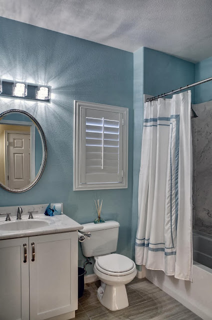 a simple bathroom in blue and white