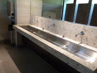 Newly renovated Ladies restroom at Snug Harbour shows stainless steel trough-style sink.