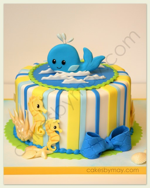 fun and whimsical whale and seahorse cake was made for a baby shower