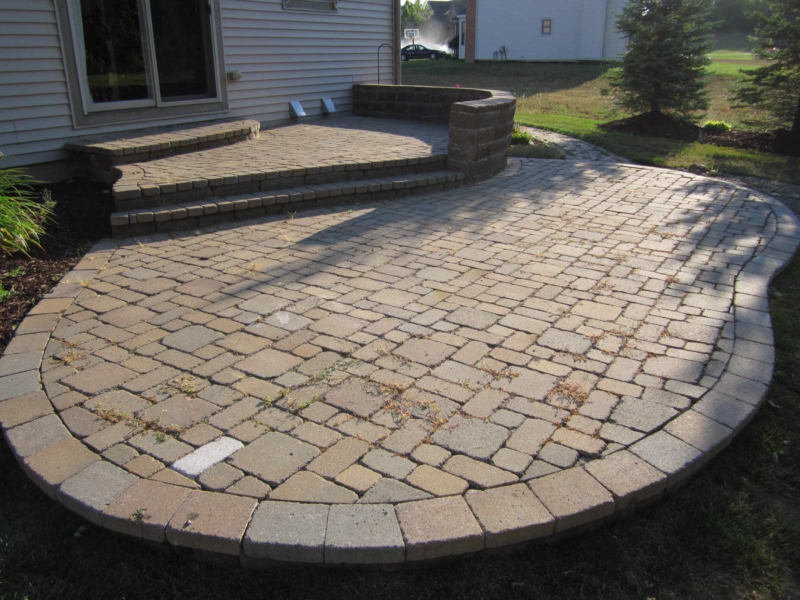Multi Level Paver Patio Is Reconstructed To One Level For Added Space