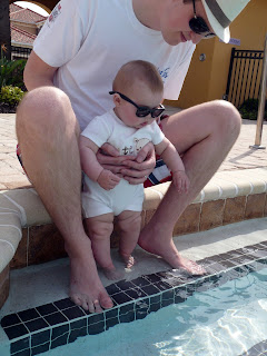 Freddie with Daddy by the pool