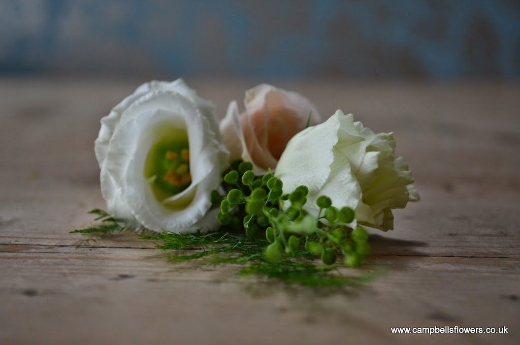 Natural sprig style buttonhole by Campbell's Flowers in Sheffield.