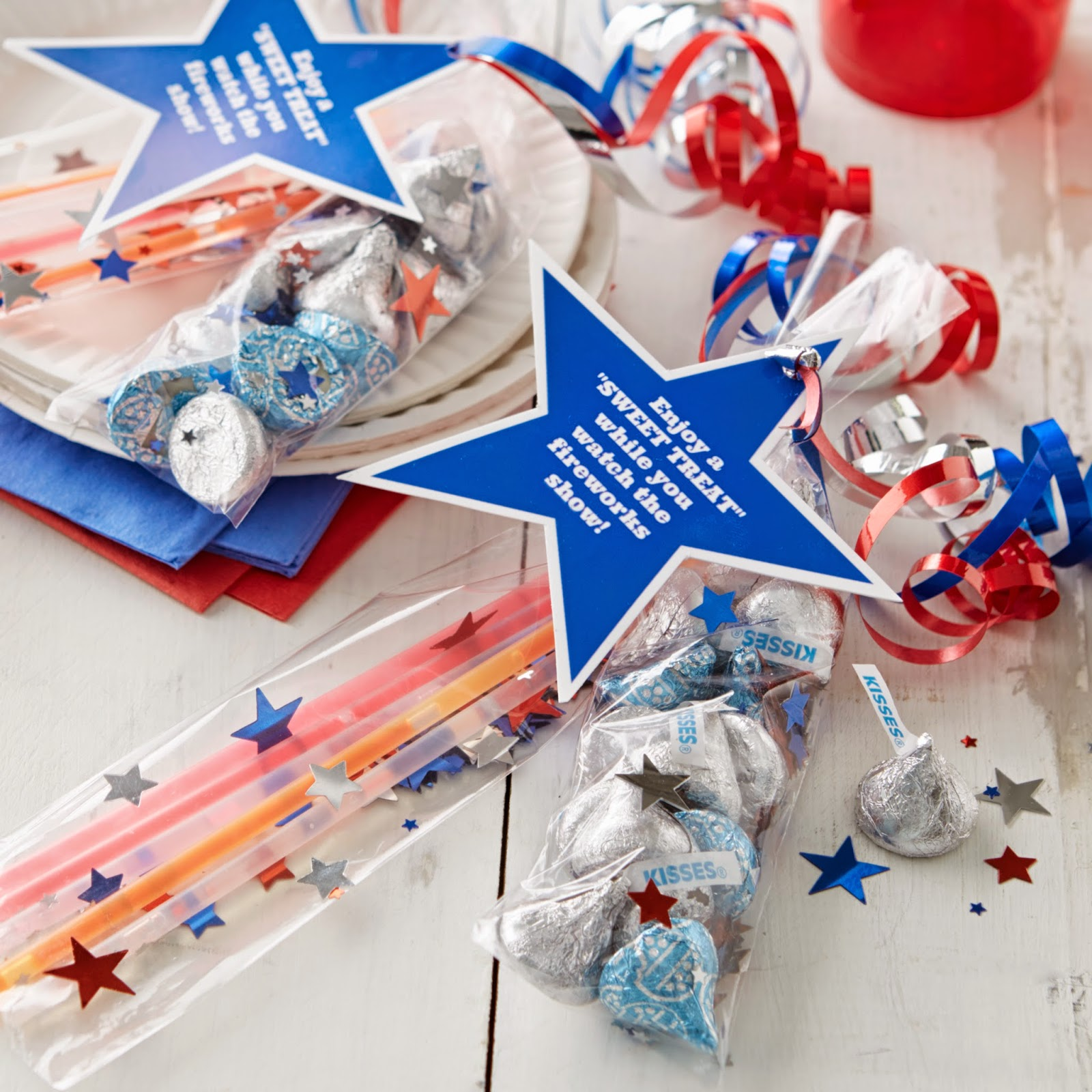 4th of July Party Favors with glow sticks and kisses! u-createcrafts.com