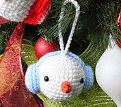 http://www.ravelry.com/patterns/library/snowman-ornament-14