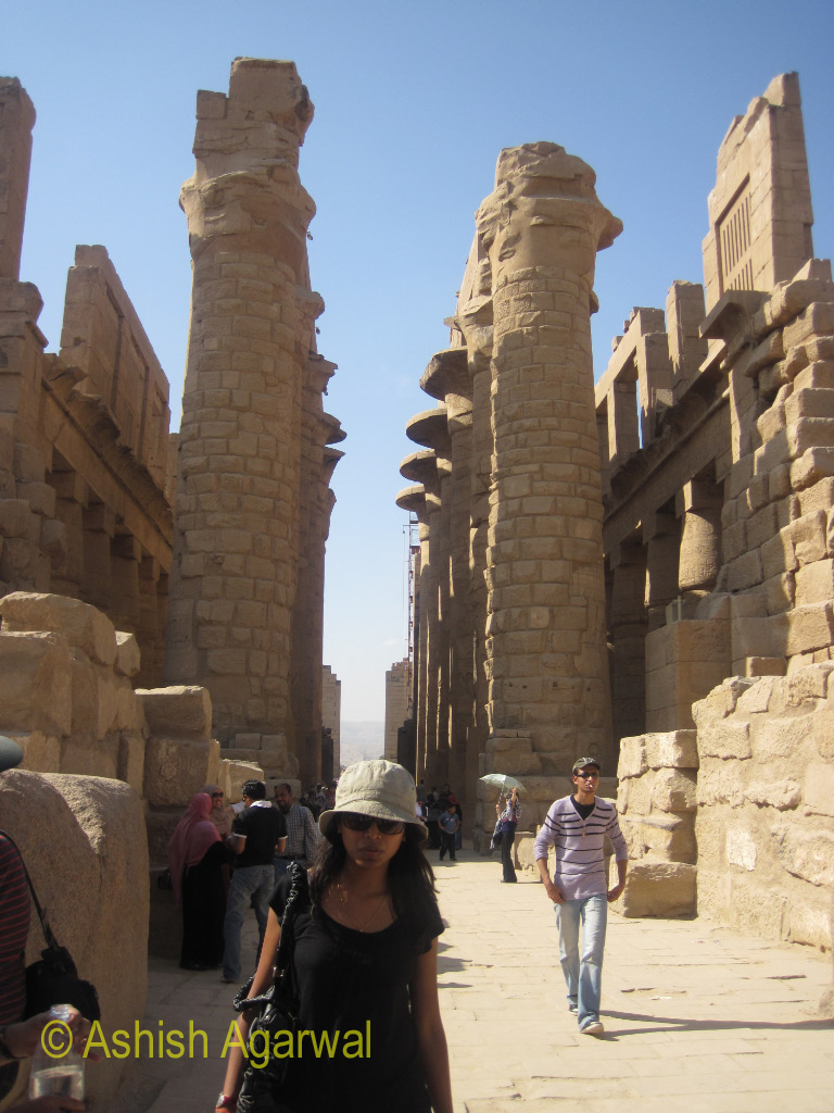 View of tourists walking through the Karnak temple in Luxor